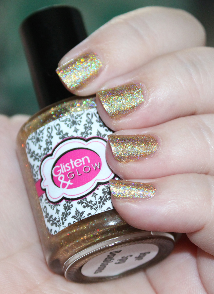 I can't stop wearing Glisten & Glow Aye Spy Dubloons- seriously! This gold holo is incredible!! See more nail art, makeup tutorials, & reviews on All Things Beautiful XO