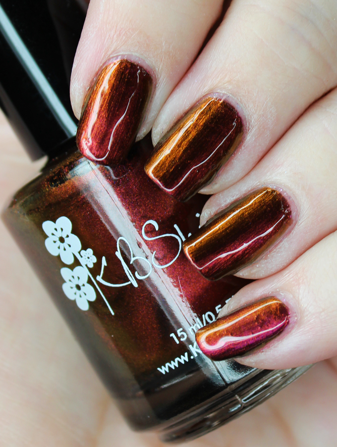 This is KBShimmer Multichrome Nail Polish in the shade It's A Blazing Swatches & review of all 6 KBShimmer Multichromes including the shades Chroma Chameleon, Puns and Roses, It's A Blazing, Flip Flop Hooray, Iridescent Exposure, & Wine Not? See more nail art, makeup, & beauty on All Things Beautiful XO