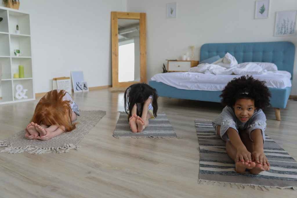 charming girls stretching in bedroom