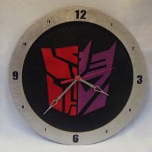 Half Autobot Half Decepticon Black Background Clock