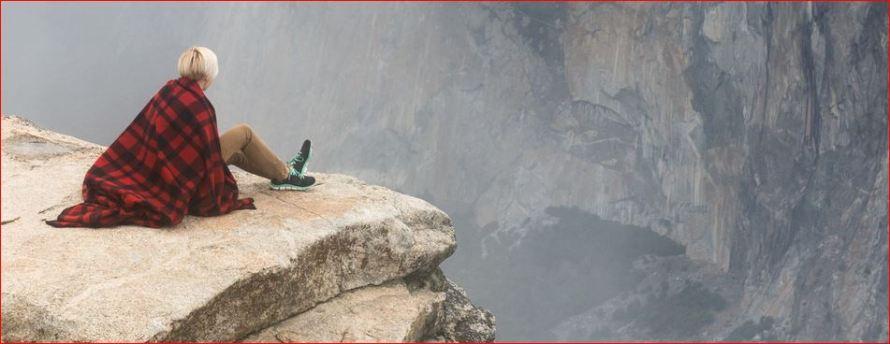 Woman on a moutain peak:The Eternal Journey