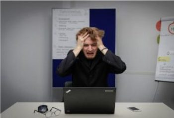 Photo of frustrated man