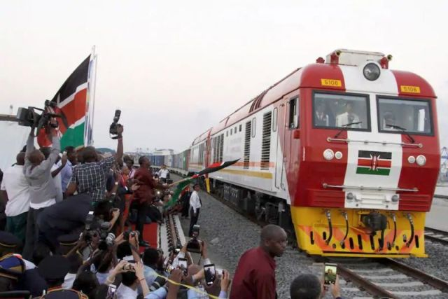 The SGR cargo train rides from the port container depot on a Chinese-backed railway in Mombasa, Kenya, on May 30, 2017. The line will eventually link East Africa to a major port on the Indian Ocean. (AP Photo/Khalil Senosi)