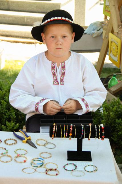 Slovak boy selling bracelets