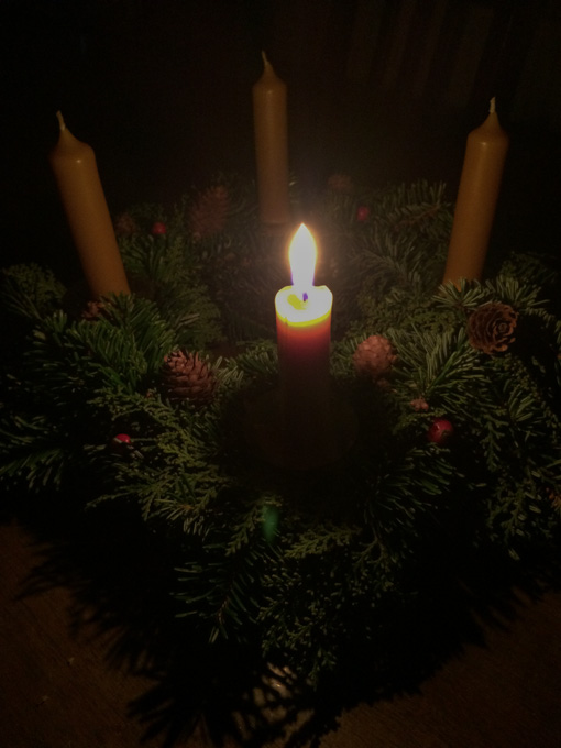 lit candle on advent wreath