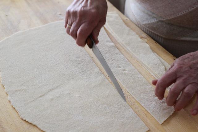 Cutting the Slovak noodle dough