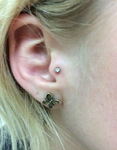 Tragus piercing almost famous body also ear piercings as acupuncture therapy rh almostfamouspiercing