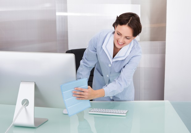 Female Worker Cleaning Office
