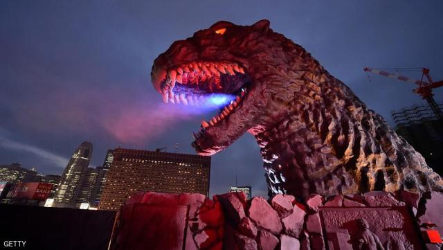 A life-size Godzilla head on a balcony of the eighth floor of Hotel Gracery Shinjuku is displayed during the official unveiling ceremony at Kabukicho shopping district in Tokyo on April 9, 2015. The Godzilla is a main feature of the new commercial complex comprising a 970-room hotel, movie theatres and restaurants which will be open this month.      AFP PHOTO / KAZUHIRO NOGI        (Photo credit should read KAZUHIRO NOGI/AFP/Getty Images)