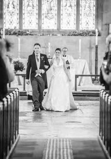 Black and white image of a bride and groom at St Michael's Church