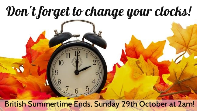 """An image of an alarm clock surrounded by Autumn leaves, with the text """"Don't Forget to Change Your Clocks! British Summertime Ends, Sunday 29th October at 2am"""