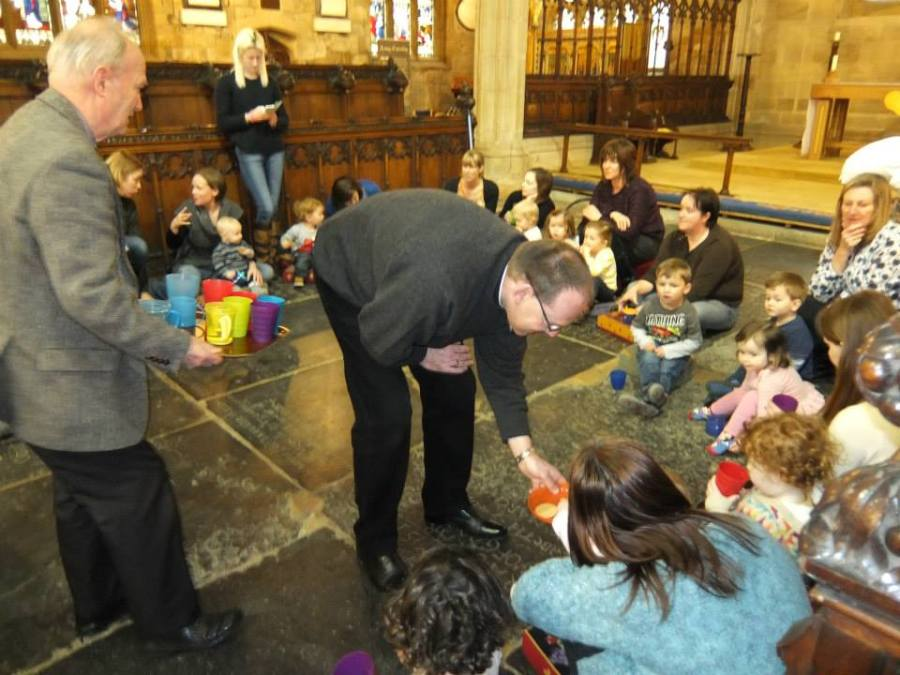 Vicar the Rev'd Paul Scott distributes much-needed biscuits
