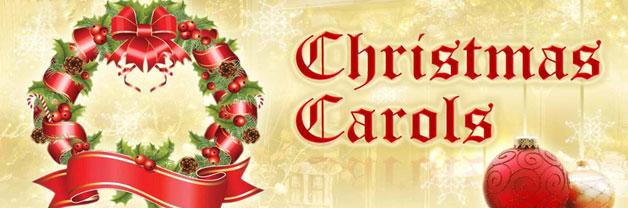 """A Christmas wreath, with text saying """"Christmas Carols"""""""