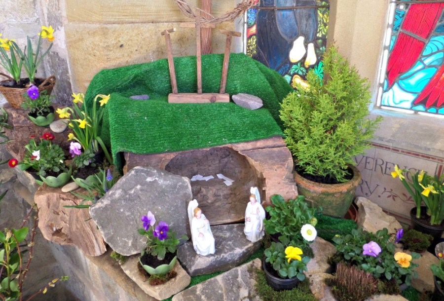 A photograph of an Easter garden at St Michael's Church. showing an open tomb