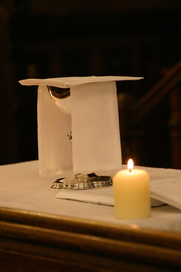 An image of a Communion chalice and candle taken at St Michael's Church