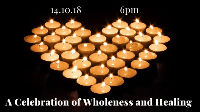"A heart shape made with lit candles, with the text ""14.10.18 6pm A Celebration of Wholeness and Healing"""