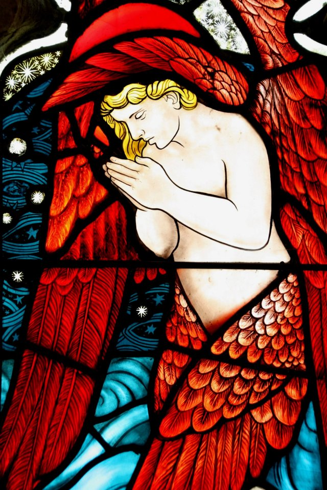 An image of a pre-raphaelite style angel in prayer, from St Michael's Church porch