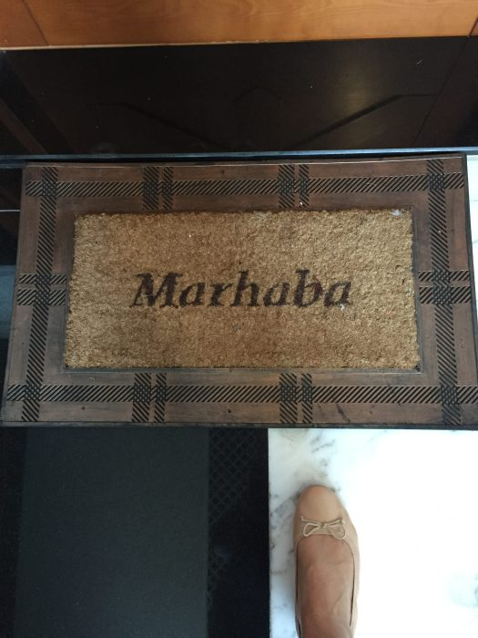 "as I walk in, I say, ""Marhaba!"" Arabic for hello."