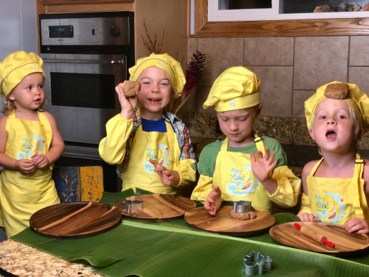 4 Johnson Kids making holiday Cookies