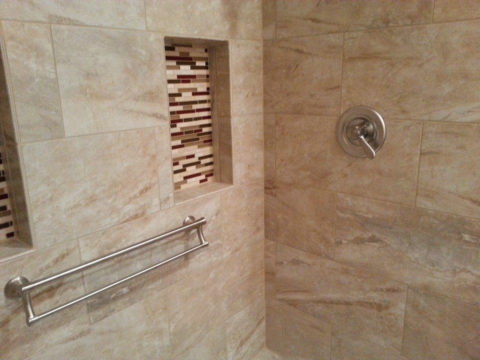 decorative grab bars for a tile shower