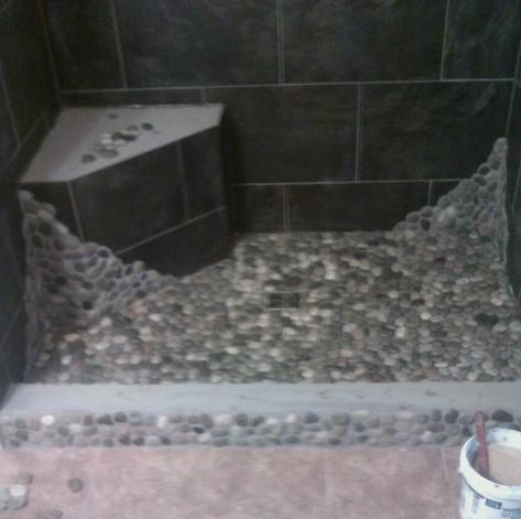 installing a pebble shower floor