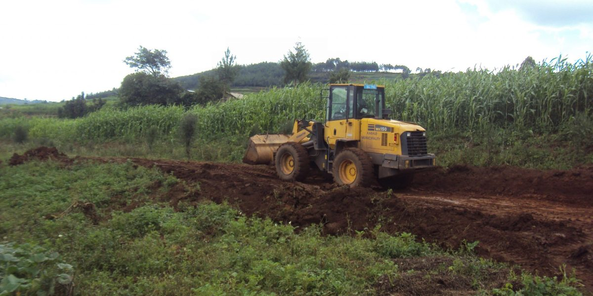 Tractor clearing the land