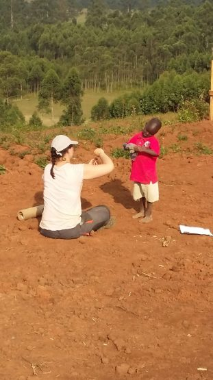 Local child Henry discussing building with student Mojca-min
