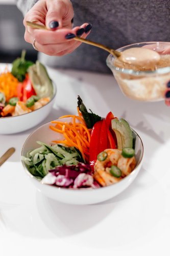 Spring Roll Bowls: Dallas blogger sharing her easy to make Whole 30 recipe for a spring roll bowl topped with creamy almond butter sauce. #Whole30 #Whole30recipe #SpringRollBowl #ShrimpRecipe