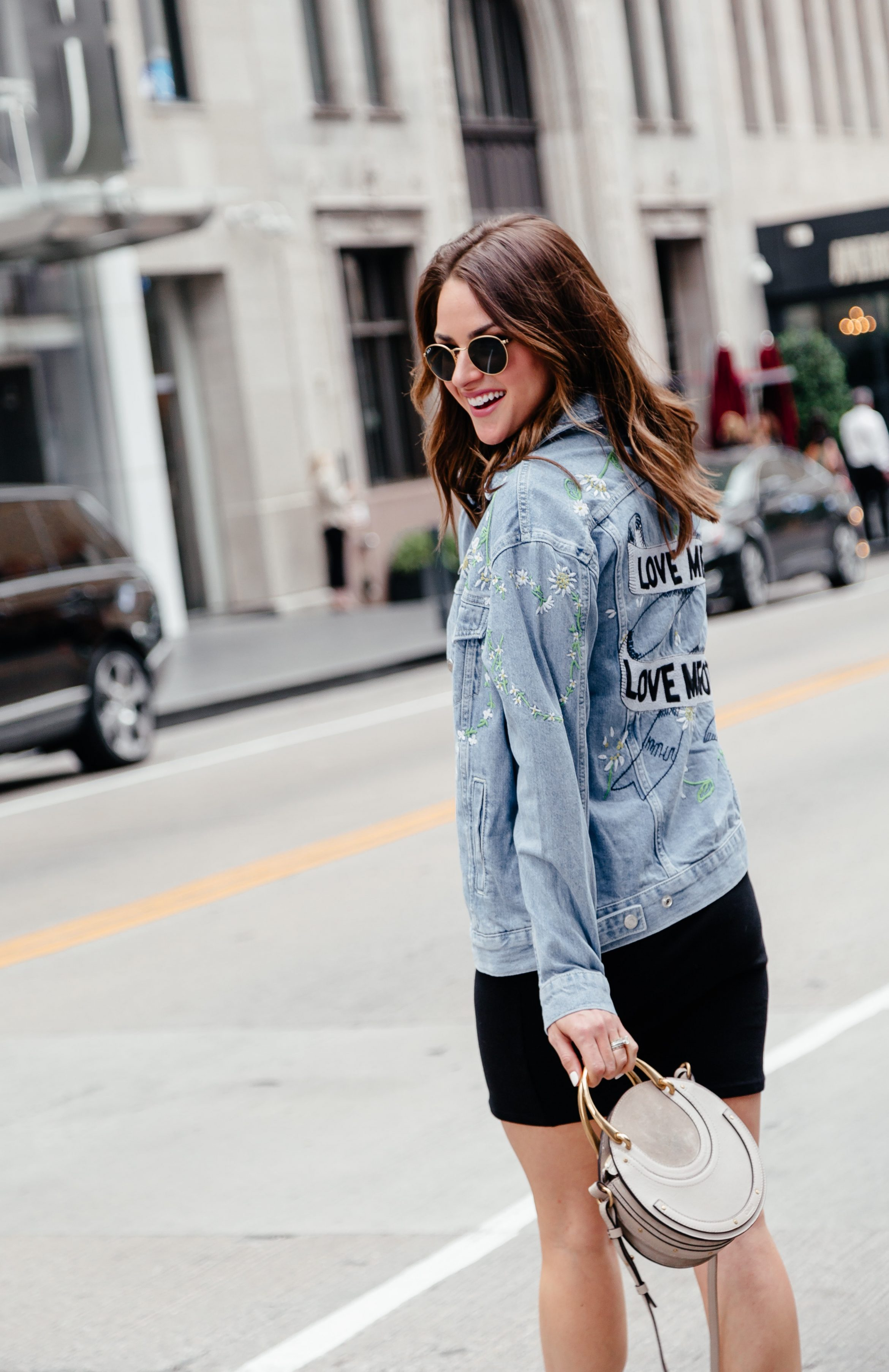A Lo Profile wearing an embroidered denim jacket from Topshop at Nordstrom  with a black dress