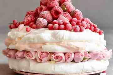 Eton mess meringue pavlova cake with berries and coconut cream