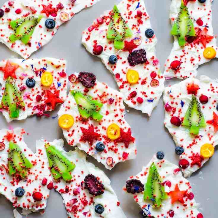 A festive frozen yogurt bark recipe that kids will love. It can be made using homemade natural yogurt or coconut yogurt, for a Vegan version, and whipped up in 10 minutes then left to freeze. A delicious & healthy snack whenever cravings hit!
