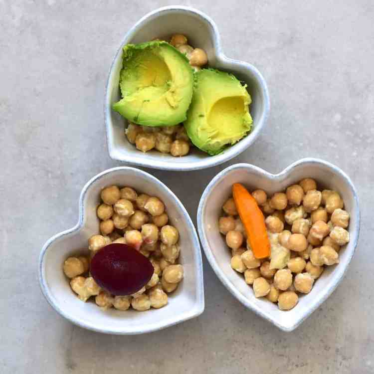 Making of three differently coloured hummus dips
