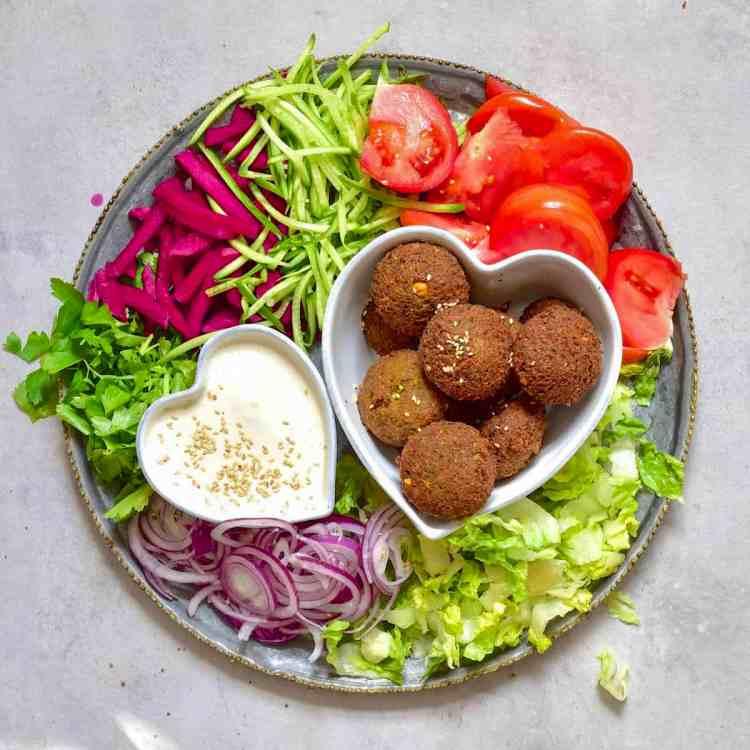 Homemade falafel on a veggie platter