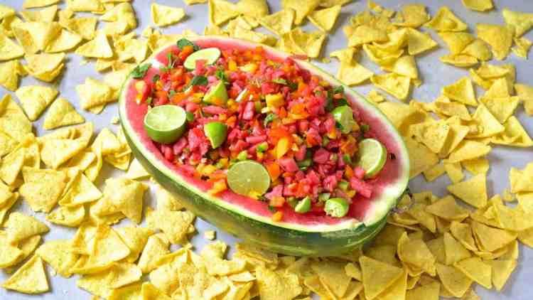Watermelon salsa served in a watermelon, crisps on side