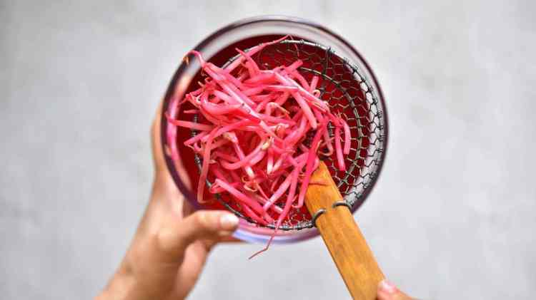 Mung bean sprouts tainted purple with beetroot
