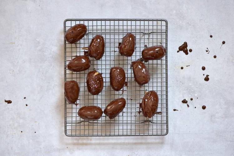 healthy vegan snack. 4-ingredient stuffed dates with home-made almond butter and dark chocolate
