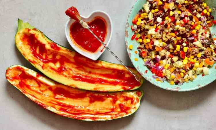 These healthy rainbow zucchini Boats are great for a nutritious, delicious filling vegetarian lunch/dinner.With a bean, corn, onion & veggie mince filling.