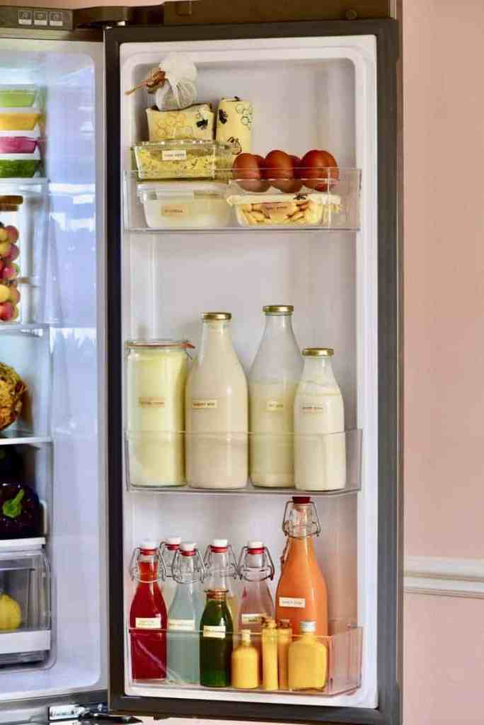 how to organise your fridge to reduce waste. what to keep in the fridge door. where to keep milk and dairy to make the most of their shelf life.