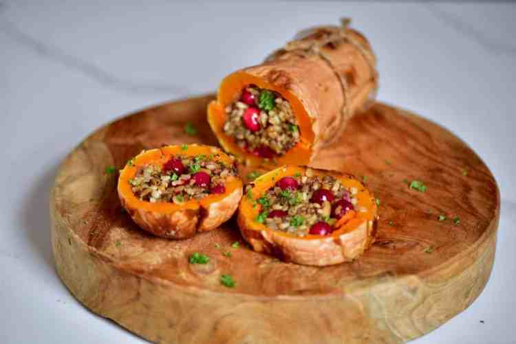 Delicious rice,mushroom & cranberry vegan stufed butternut squash christmas recipe. A wonderful vegan roast alternative for a meat-free christmas
