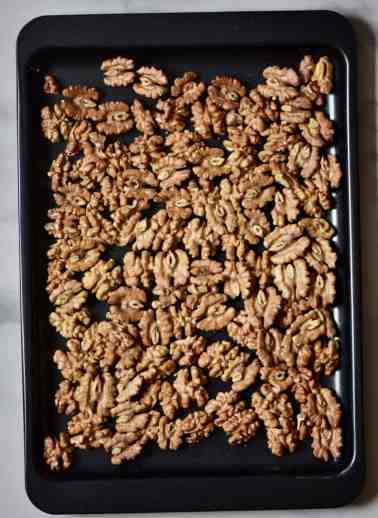 roasted walnuts on an oven tray