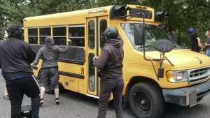Protesters attack school bus