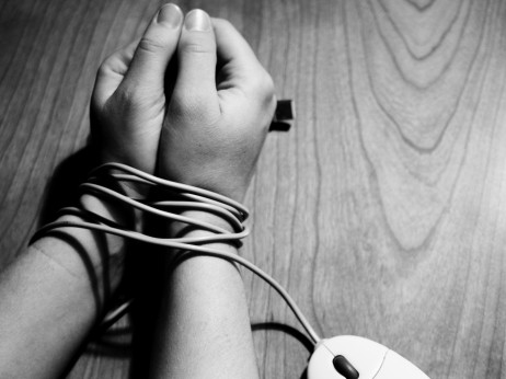 Hands-bound-by-cord-462x346