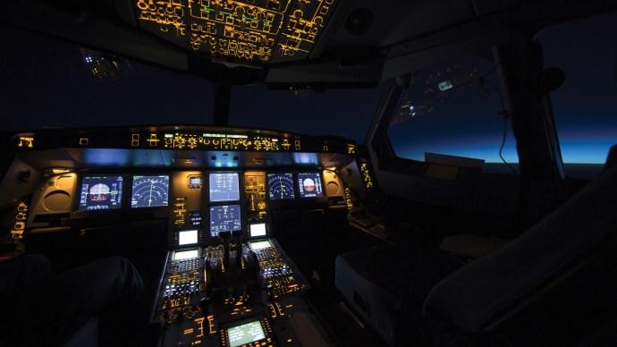 tech-is-rewiring-your-brain-aeroplane-cockpit-nighttime