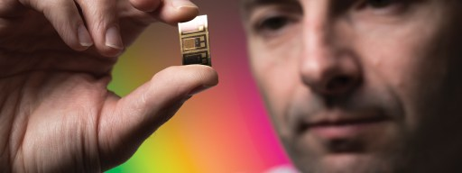 dr-richard-curry-university-of-surrey-light-speed-computers-holding-chip