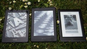 The new Paperwhite sits in the centre, with the Voyage to its left and the Kobo Glo HD to the right