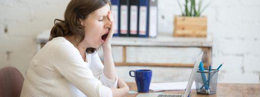 bigstock-sleepy-young-worker-woman-yawn-143681474