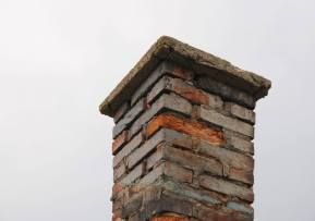 spalling masonry chimney