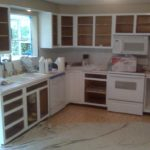 The steps in putting in new kitchen cabinets