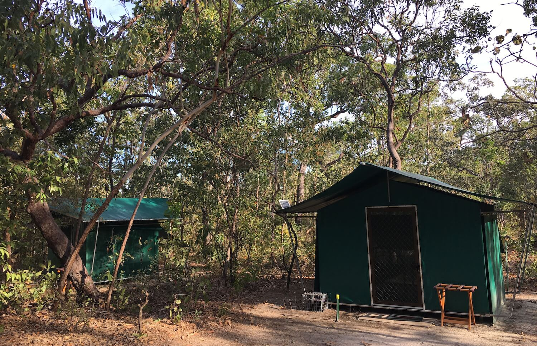 The huts at Sab's campsite with mesh walls.