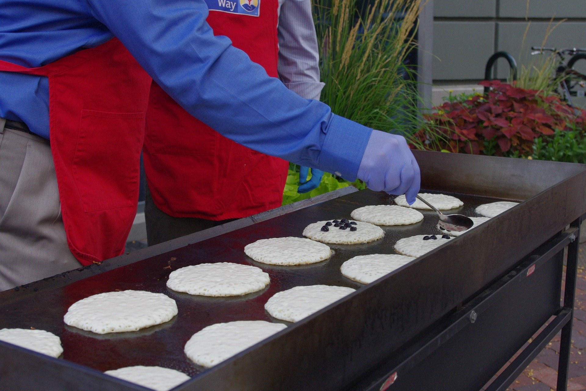 Pancakes on a grill.